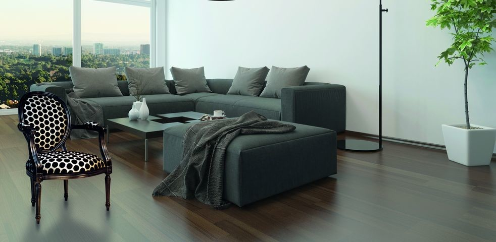 Living room interior w. gray couch and floor lamp